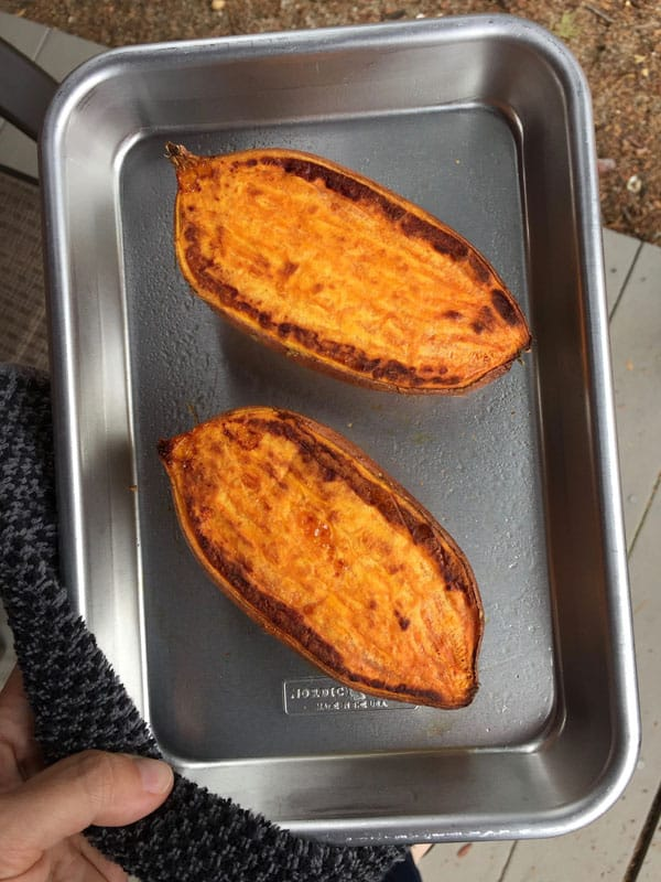 Baked sweet potato halves on an 1/8th metal sheet pan.