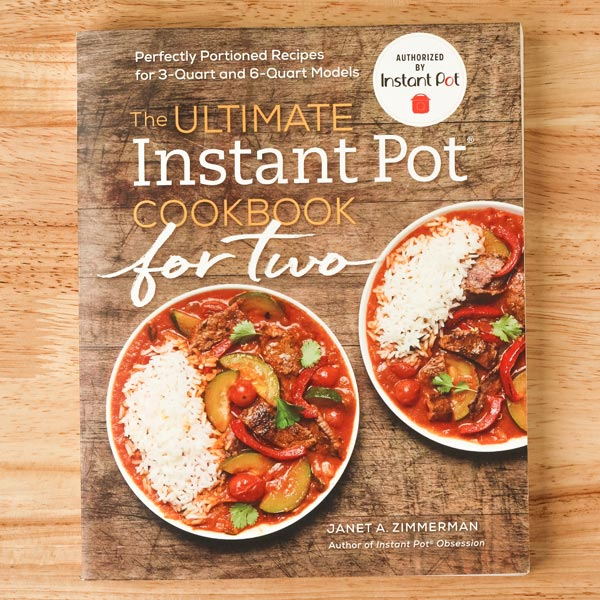 The Ultimate Instant Pot Cookbook For Two book cover featuring two bowls of rice and stew.