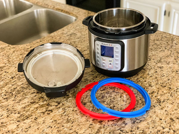 Instant Pot Mini on counter with blue and red silicone rings.