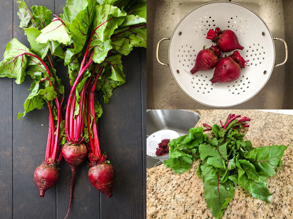 Beets with greens removed and rinsed in a white colander.
