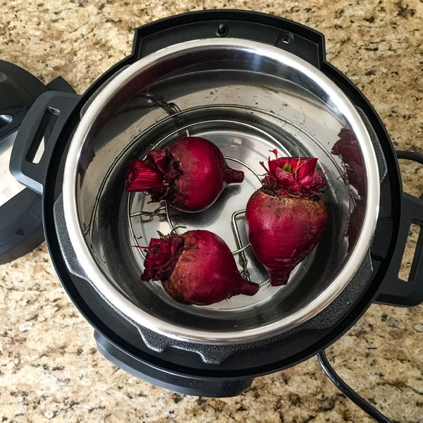 Beets on a rack inside of a 3 quart instant pot mini.