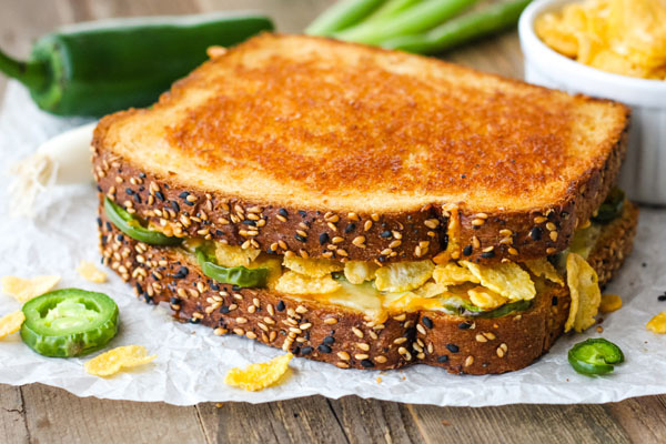 Jalapeno Popper Grilled Cheese on a piece of parchment paper.