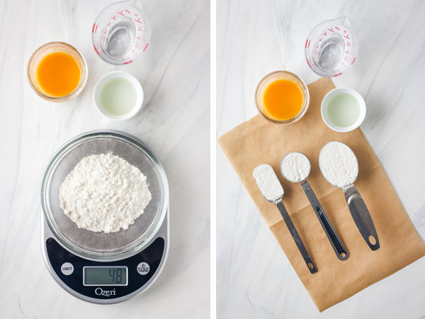 Cake mix measured in a bowl on a scale and using measuring spoons.