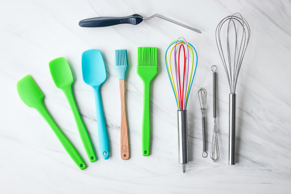 Mini rubber spatula, whisks, silicone brushes, and an offset spatula.