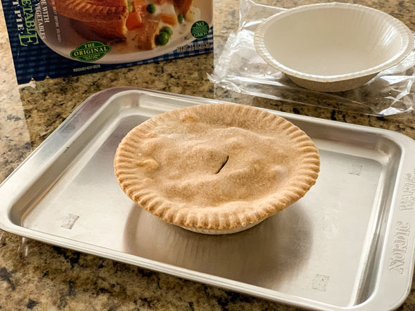 Frozen vegetarian pot pie on a small baking sheet.
