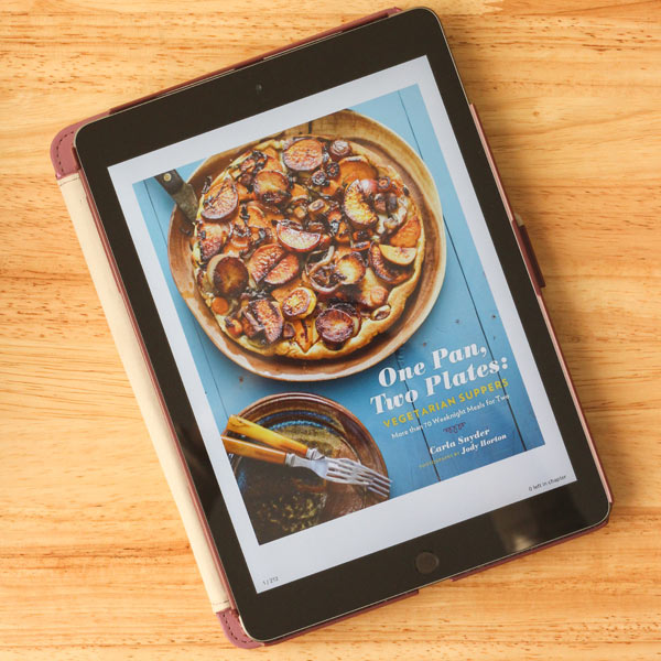 One Pan, Two Plates Vegetarian Suppers digital book cover on a tablet.