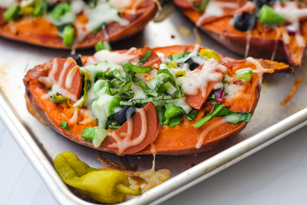 Baked sweet potatoes on a quarter sheet pan.