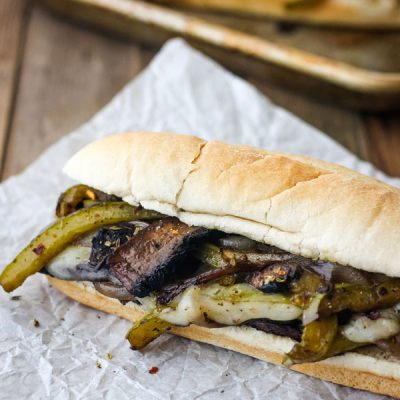 Portobello Mushroom Sandwich on a piece of parchment paper.