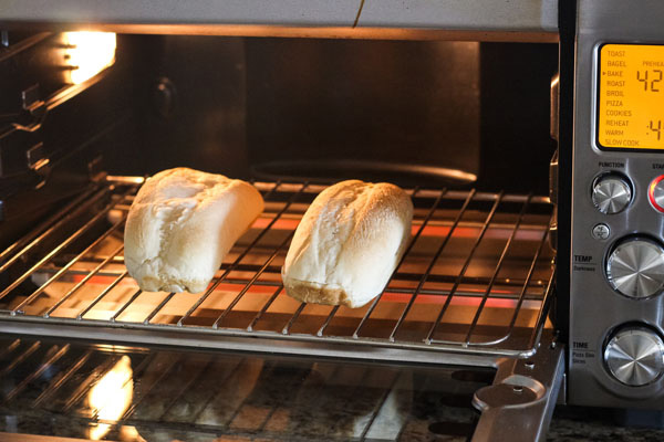 Rolls on a cooking rack inside a countertop oven.