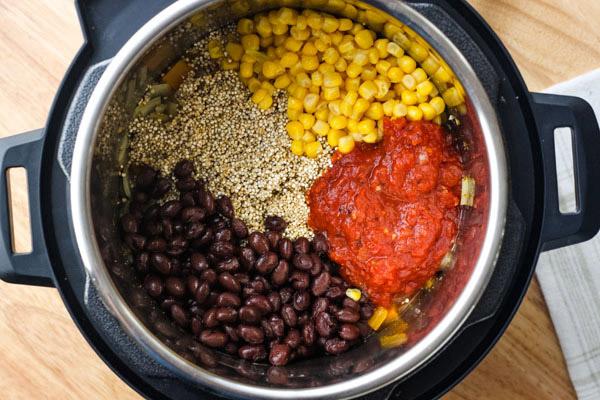Black beans, corn, salsa, and quinoa inside a 3 quart instant pot.