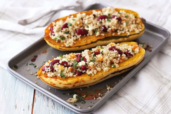Roasted delicata squash boats stuffed with a quinoa salad on a toaster oven pan.