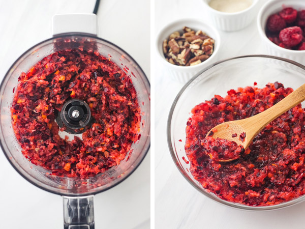 Chopped cranberry and orange in a mini food processor and in a small glass bowl with a wooden spoon.