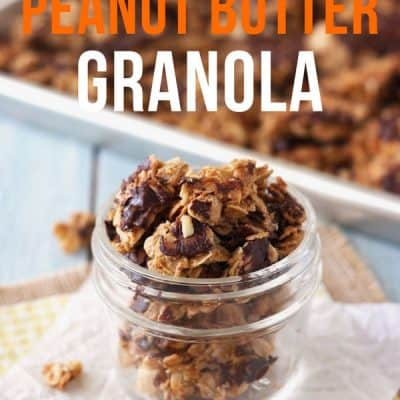 Clusters of chocolate covered peanut butter granola in a small glass jar.
