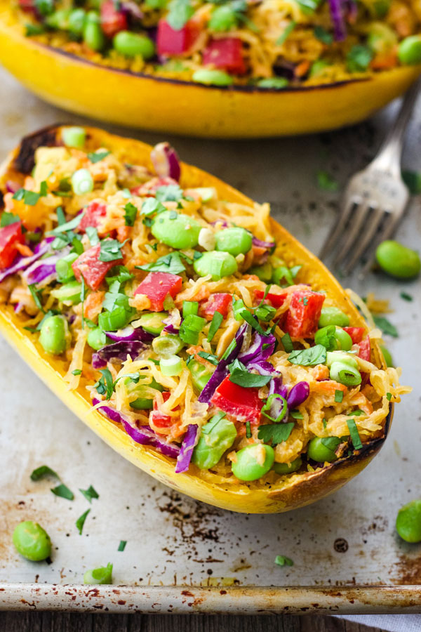 Spaghetti Squash Bowls with Peanut Sauce on a metal baking pan.