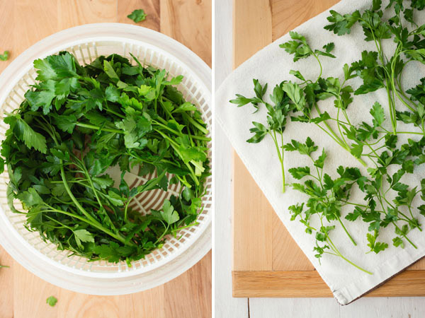 First Photo: Fresh herbs in a salad spinner. Second Photo: Herbs drying on a white dish towel.