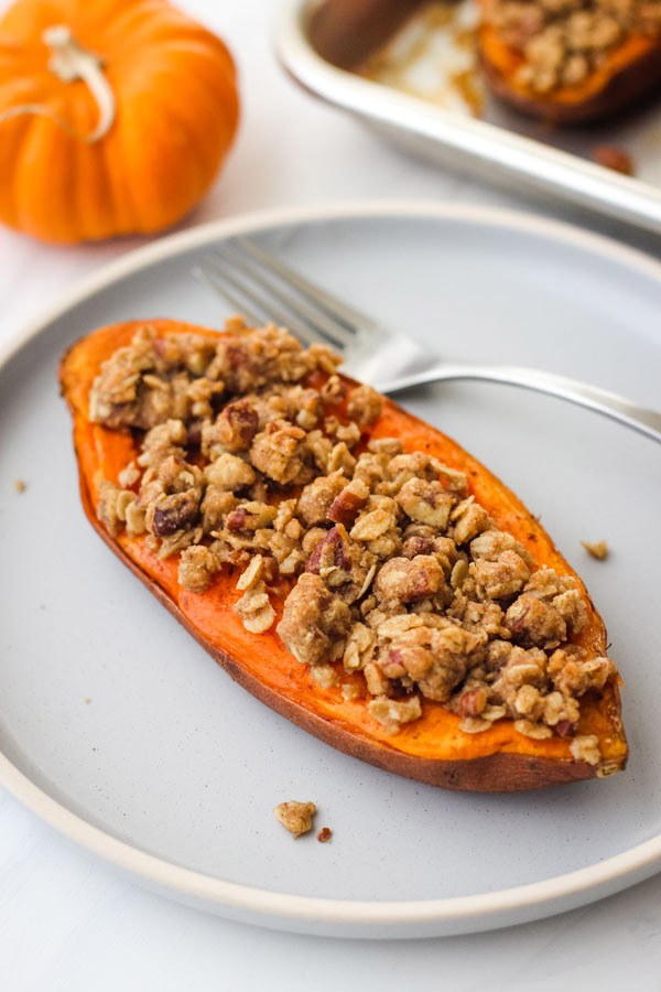 Twice baked sweet potato on a blue plate.