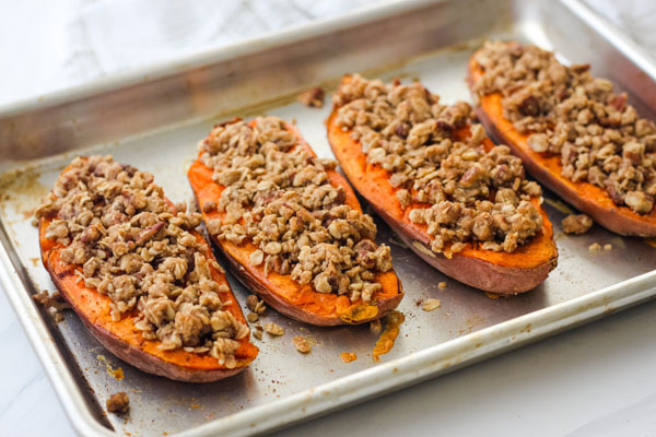 Baked Streusel Topped Sweet Potatoes on a quarter sheet pan.
