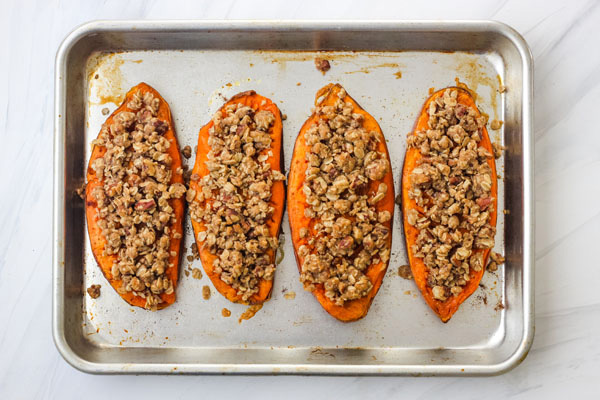 Streusel Topped Sweet Potatoes on a quarter sheet pan.