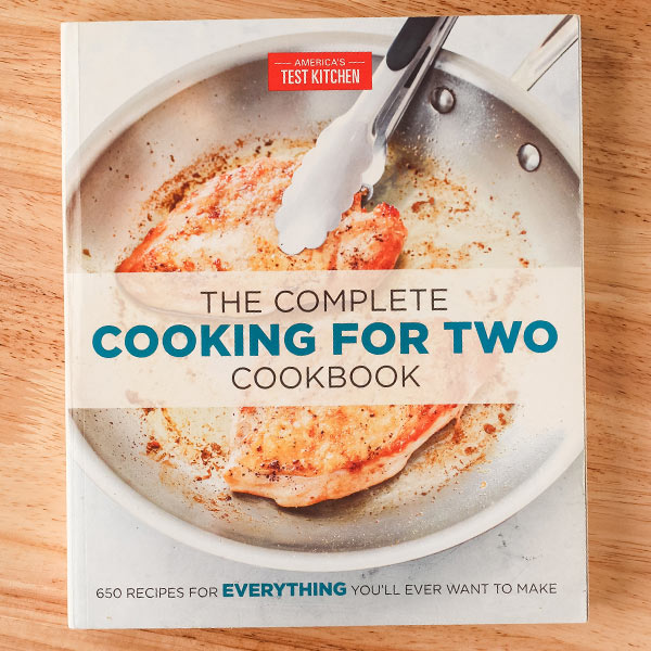 The Complete Cooking For Two Cookbook book cover with chicken breasts cooking in a skillet.