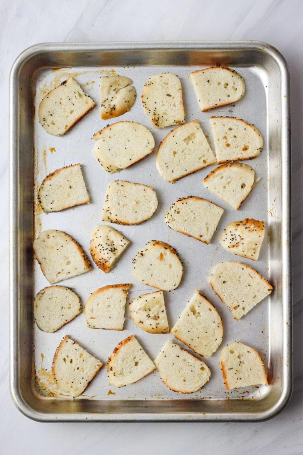 Bagel pieces on a quarter sheet pan.