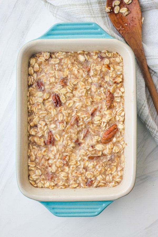Banana oatmeal mixture in a small blue baking dish.