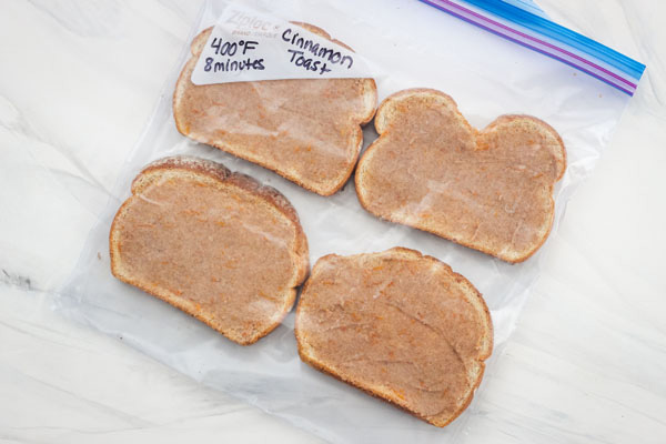 Frozen cinnamon toast slices in a large plastic bag.