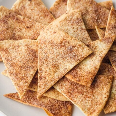 Cinnamon sugar chips on plate with blue napkin.