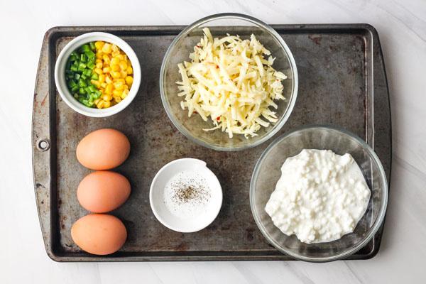 Egg Bake Ingredients on a metal baking sheet.