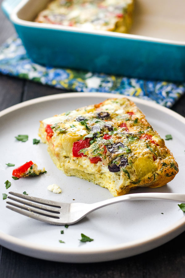 Herby frittata on a plate with a fork.