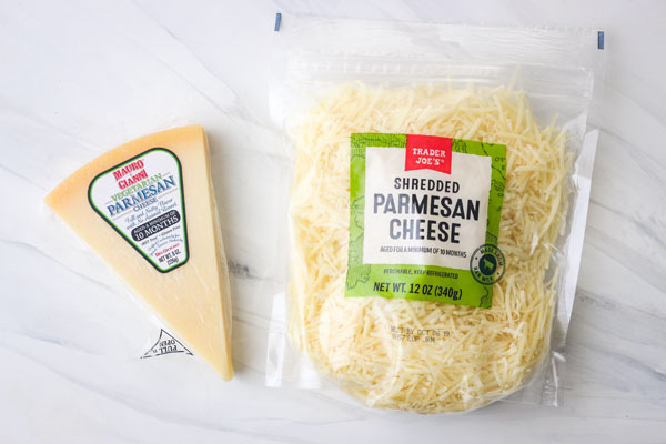 Bag and wedge of vegetarian parmesan cheese.