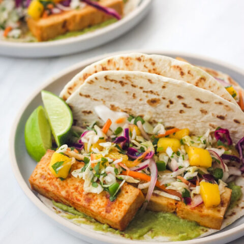 Tofu Tacos with Mango Slaw on a blue plate.