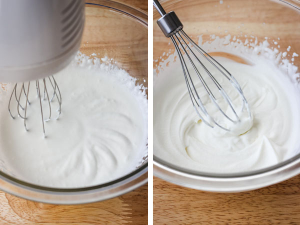 A glass bowl of cream whipped by a hand mixer and a bowl of whipped cream with a whisk