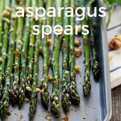 Gorgeous balsamic drizzled asparagus spears on a small toaster oven baking sheet.
