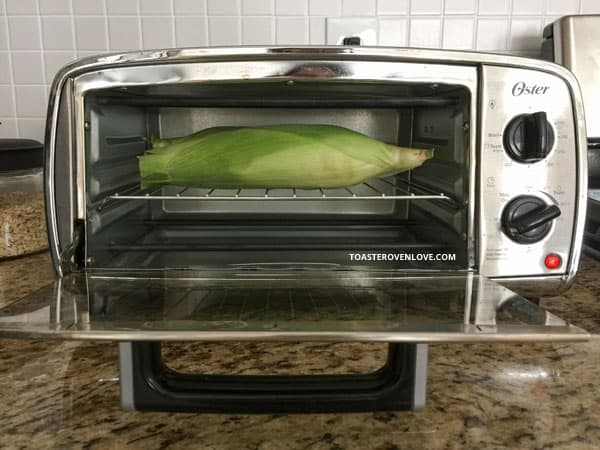 When baking corn on the cob make sure the husks are not touching any of the walls of your toaster oven.