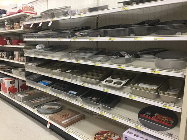 Shelves of baking pans in a department store.