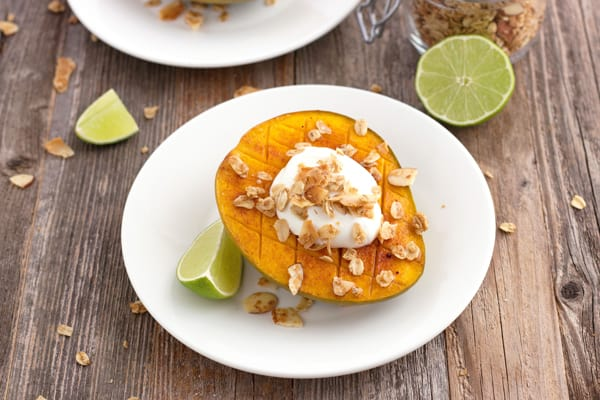 Toaster oven broiled mango topped with Greek yogurt and granola