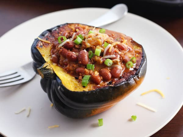 cooked acorn squash bowl filled with vegetarian chili
