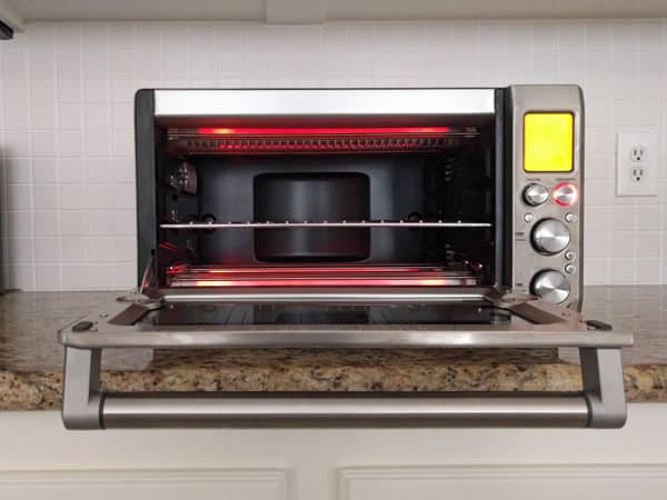 Wait for your toaster oven to cool down completely before cleaning. The elements are hot and should be avoided.