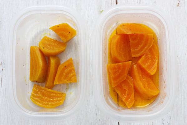 Two containers of golden beets, one with vinegar and one plain.
