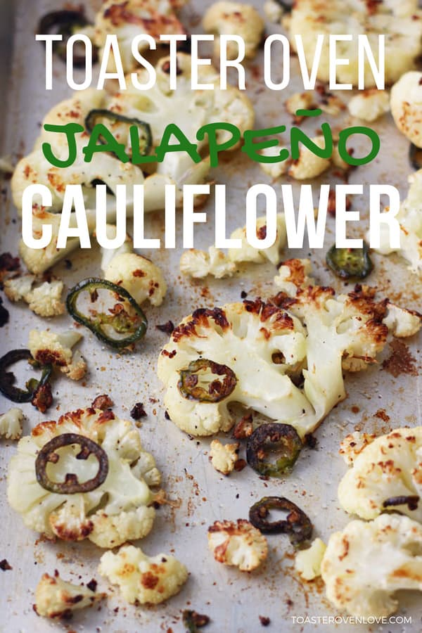 Toaster oven roasted cauliflower with jalapeno slices on a baking sheet.