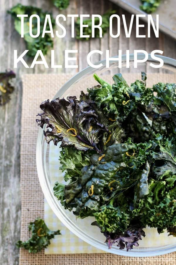 Flaky kale chips in a glass bowl.