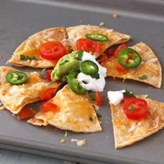 Nachos with Greek yogurt and jalapeno slices.