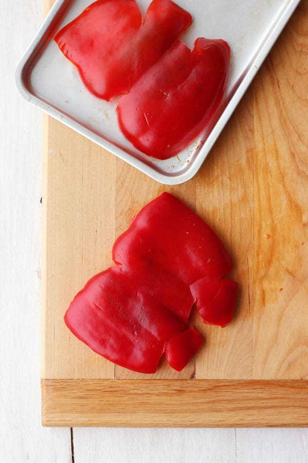 Red pepper halves on a toaster oven baking pan.