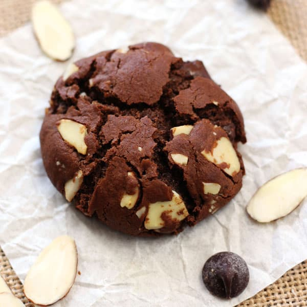 Small batch chocolate cookie bursting with sliced almonds and chocolate chips.
