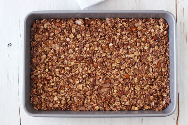 Small batch granola pressed into an even layer in a small baking pan.