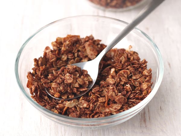 A small bowl of flaky granola that was stirred while baking.