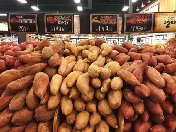 Sweet potato varieties at a grocery store.