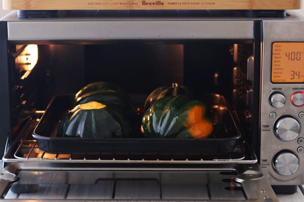 acorn squash cooking in a Breville toaster oven