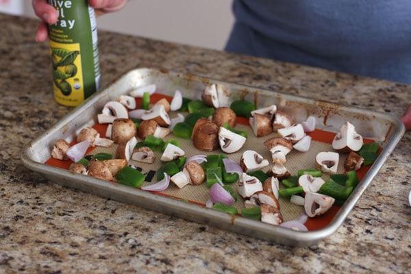 Chopped vegetables on a quarter sheet pan