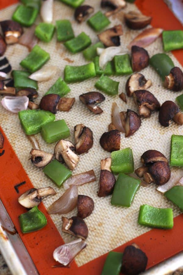 Roasted vegetables on a quarter sheet pan.